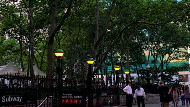 men walking, relaxing in bryant park on a summer day - bryant park stock videos & royalty-free footage