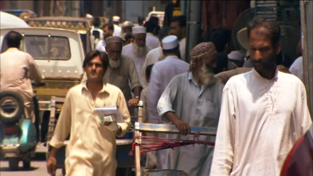 Men walking through busy street in the Swat District