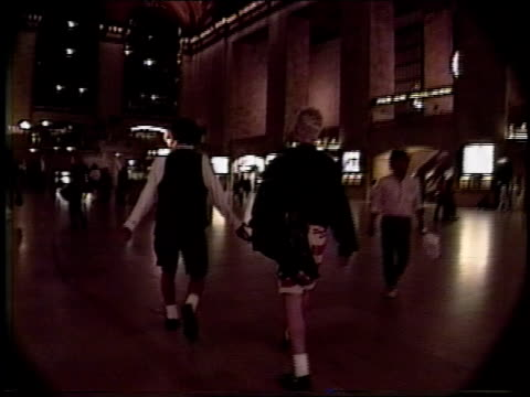 men walking through nyc's grand central station at night - grand central station manhattan stock videos & royalty-free footage