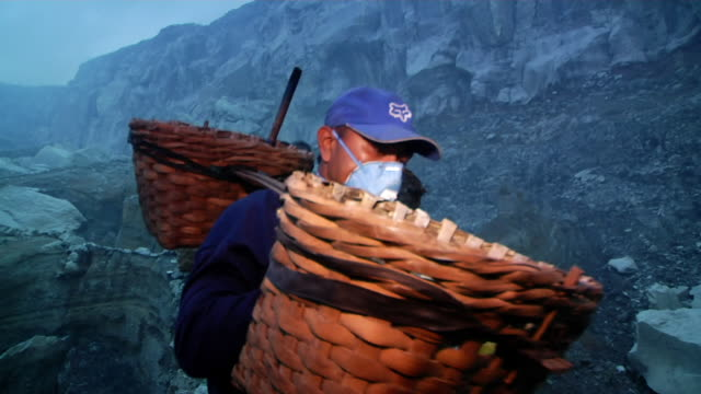 ms men walking to the sulfur mining at early morning / ijen, java, indonesia - mineral stock videos & royalty-free footage