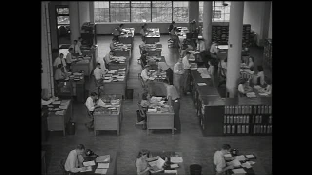 men walking toward building; floor full of people working behind office desks and men distributing paperworks - 1940 1949 stock videos & royalty-free footage