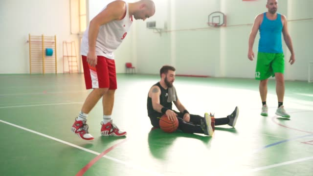 men warming up before playing basketball - cestino video stock e b–roll