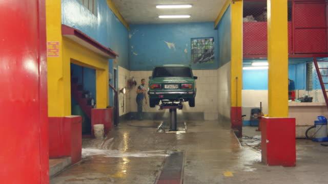 men washing a car at a car garage in havana, cuba - car wash stock videos & royalty-free footage