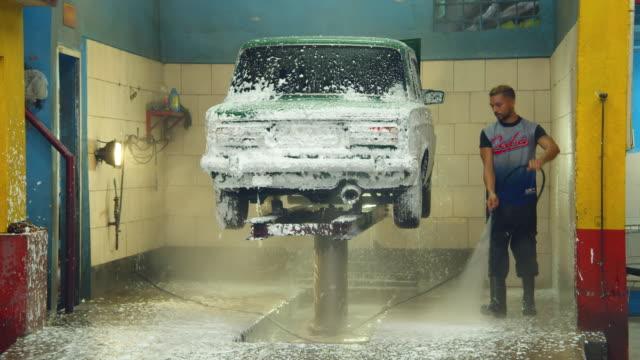 men washing a car at a cuban auto repair shop. havana - car wash stock videos & royalty-free footage