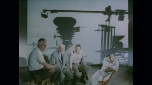 1958 men watch an animated trapezoid with a bar through its center move - 1958 stock videos and b-roll footage
