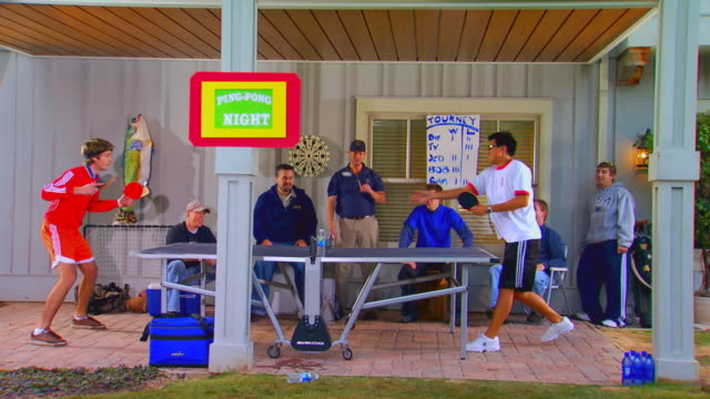 men watching and playing in a ping pong tournament - table tennis bat stock videos & royalty-free footage