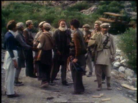 men waving at the camera / peshawar, pakistan - peshawar stock videos & royalty-free footage