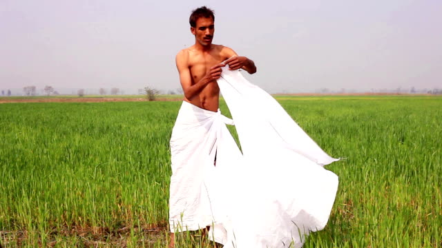 men wearing dhoti which is traditional dress in rural india - dhoti video stock e b–roll