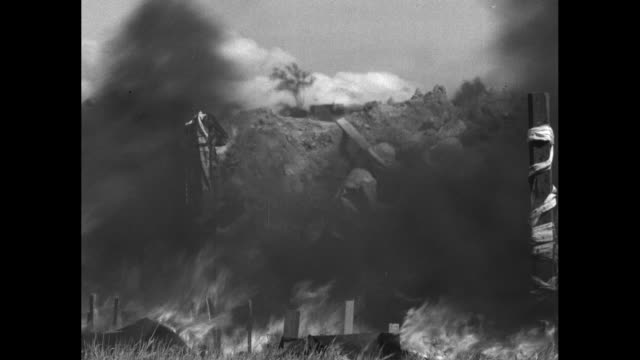 men wearing fireproof suits made of asbestos make their way down a small slope to a fire; they spray the fire with hoses, beat it with shovels /... - french language stock videos & royalty-free footage