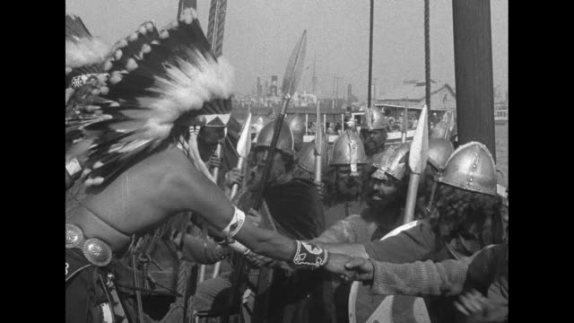 men wearing vikings costumes and beards rowing viking longboat past dock as they arrive at the pacific southwest exposition / shot on board ship of... - unvollständig stock-videos und b-roll-filmmaterial