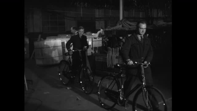 men wheel out various bicycle designs in factory; 1952 - collection stock videos & royalty-free footage