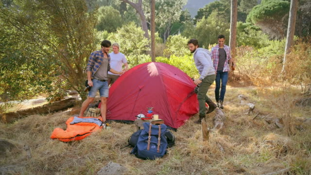 Men with beer by tent