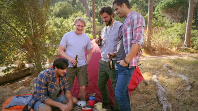 men with beer by tent - アウトドア点の映像素材/bロール