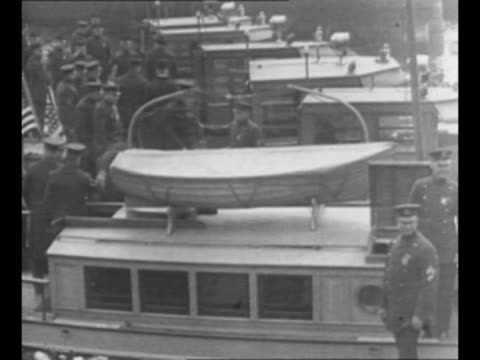 men with crates of liquor / row of harbor police boats at dock in new york city in 1924 with police standing on dock nearby / montage harbor police... - bimini stock videos & royalty-free footage