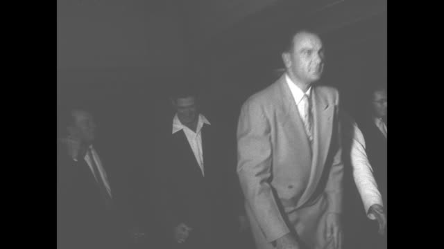 ms men with former us representative rudolph king as he holds plaque king is now registrar of motor vehicles in ma / men walk past camera / people... - plakette stock-videos und b-roll-filmmaterial