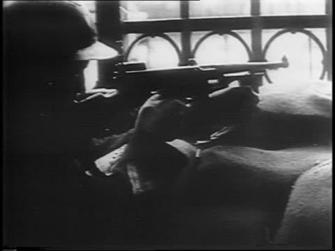 men with guns sit in chairs on street / man with pistol walking towards other men / group of men peering around corner / wideshot of people walking... - handgun stock videos & royalty-free footage