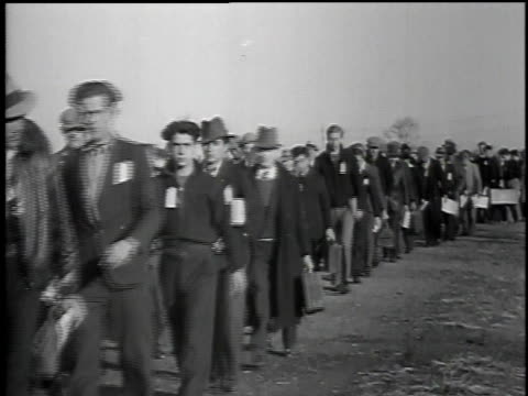 montage men with paperwork entering tents to join the civilian conservation corps / united states - civilian conservation corps stock-videos und b-roll-filmmaterial