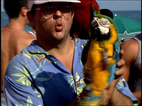 Men with Parrots Snakes on Miami Beach