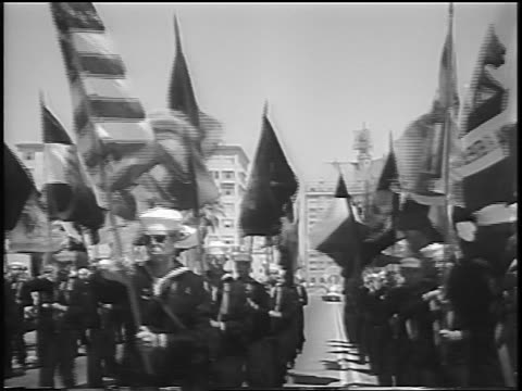 b/w 1956 men with sailor uniforms marching with flags in miss universe parade / long beach ca / news - spielkandidat stock-videos und b-roll-filmmaterial
