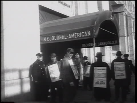 b/w 1962 men with sandwich boards in newspaper strike picket line under awning / nyc - newspaper strike stock videos & royalty-free footage