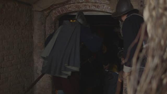 men with weapons kicking door open - tudor/elizabethan era reenactment - army soldier stock videos & royalty-free footage