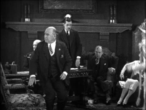 b/w 1926 men (one is charley chase)+ woman in office rising concerned / feature - 1926 stock videos & royalty-free footage