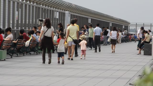 men women and children enjoy observation deck at narita international airport terminal 1 - 夏休み点の映像素材/bロール