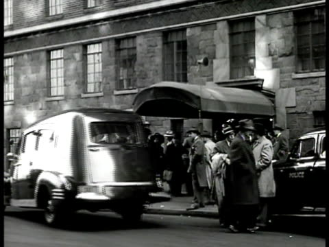 crime men women opening urban apartment windows looking into street people gathered at awning entrance to apartment building ambulance pulling up... - 1946 stock videos and b-roll footage