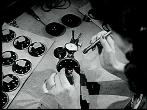 1945 b/w montage men + women working in television manufacturing factory, assembling + testing tv / usa / audio - film montage stock videos & royalty-free footage