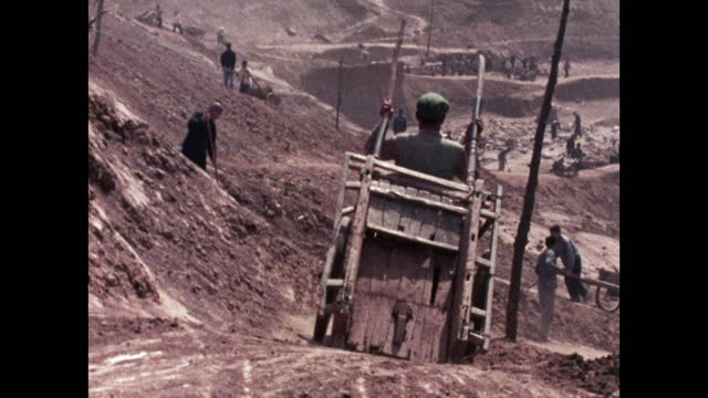 men work hard pulling carts in reservoir construction site; 1973 - maoism stock videos & royalty-free footage
