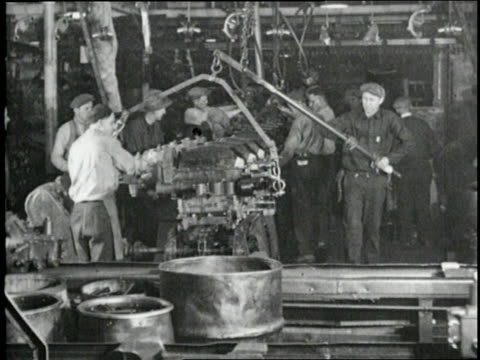 men work on assembly lines making the model a fords. - ford motor company stock videos & royalty-free footage