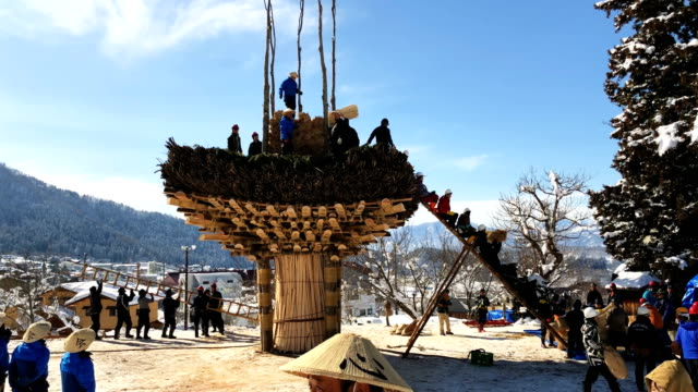 Men work on constructing the shrine during preparations for the Nozawaonsen Dosojin Fire Festival on January 15 2018 in Nozawaonsen Japan The...