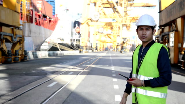 men worker and cargo containers in shipping - control stock videos and b-roll footage
