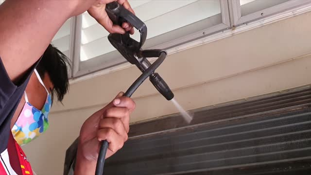 men worker fixing and cleaning electrician air conditioner dirty in home - technician stock videos & royalty-free footage