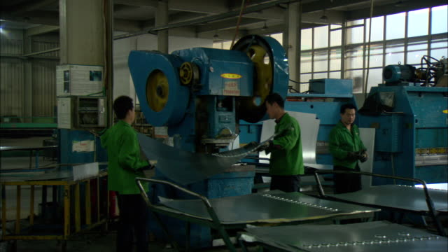 ms zo ws men working at assembly line in himin solar energy group factory, making parts for solar hot water heaters, dezhou, shandong, china - aluminium stock videos & royalty-free footage