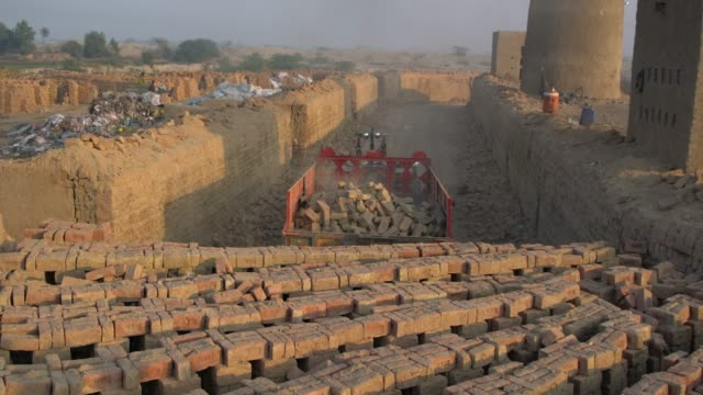 men working at brick kiln factory, using traditional or artisan technologies for brick-making, punjab, pakistan - mud stock videos & royalty-free footage