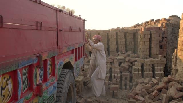 men working at brick kiln, using traditional or artisan technologies for brick-making, punjab, pakistan - pavel gospodinov stock videos & royalty-free footage