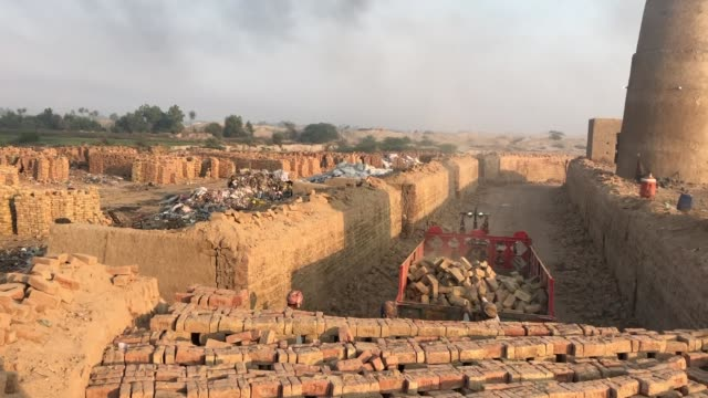men working at brick kiln, using traditional or artisan technologies for brick-making, punjab, pakistan - brick stock videos & royalty-free footage