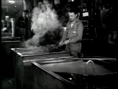 men working at furnaces, male cooling airplane part in water trough. male worker taking heated ring out of furnace, metal cooling in water, steam... - trough stock videos & royalty-free footage