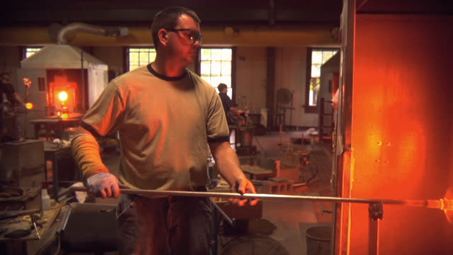 WS DS Men working at glass blowing factory / Windsor, Vermont, USA