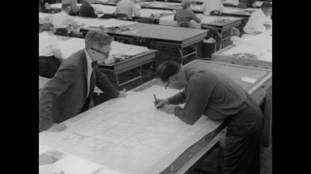 1960 men working at the georgraphy division fo the census bureau, man draws a fine line on map - census stock videos & royalty-free footage