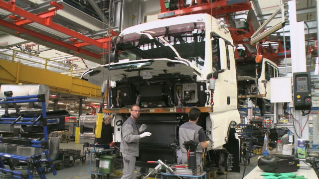WS Men working at truck production MAN AG / Munich, Bavaria, Germany