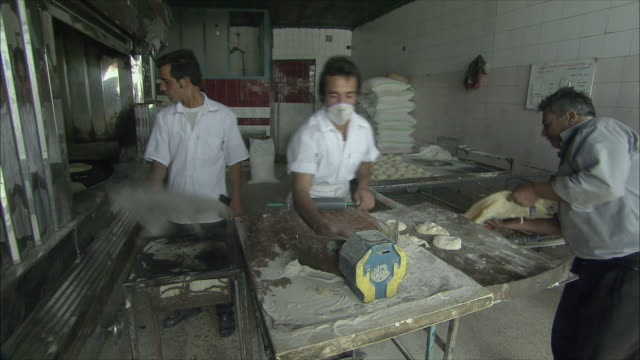 ms pan men working in bakery, iran - iran stock videos & royalty-free footage