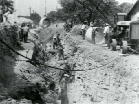 B/W 1934 men working in ditch in WPA sewage construction project / documentary