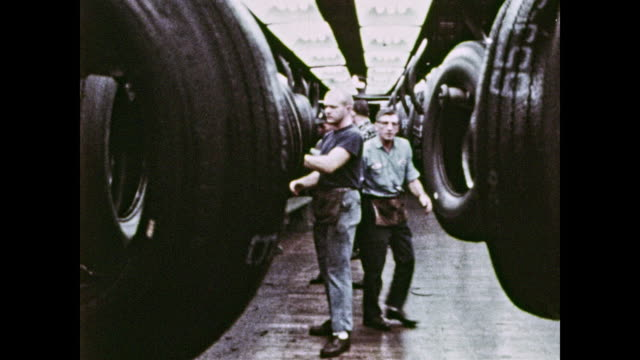 men working in tire factory - tyre stock videos & royalty-free footage