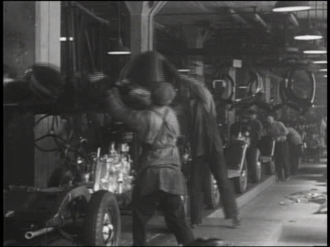 b/w men working on assembly line in car factory - car plant stock videos & royalty-free footage
