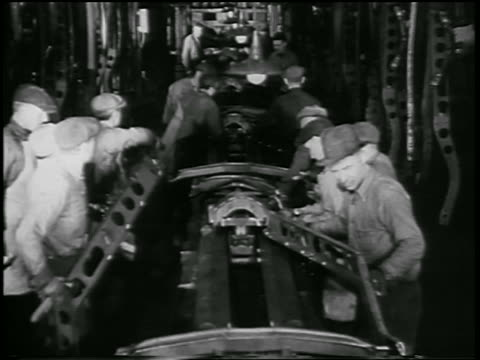 b/w 1932 men working on assembly line in ford car factory / industrial - 1932 stock videos & royalty-free footage