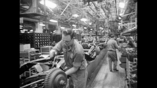 ws men working on car production line; 1964 - production line worker stock videos & royalty-free footage