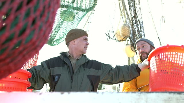 men working on commercial fishing boat - fisherman stock videos & royalty-free footage