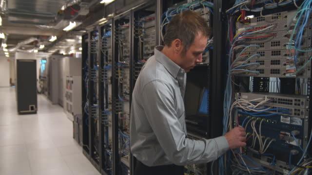 MS Men working on computer servers, Sydney, Australia